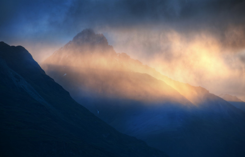 "<h2>Evening Light on the Remarkables</h2> Misty and cloudy on the mountains... from this far away, it looks like a mist is blowing across the tops of the mountains.  It makes it all appear more dramatic than perhaps it really is while you are there.  But I guess there is this idea of relative drama.  If you are actually there on the mountain, it's probably quite mild and pretty.  But, from way back here, dozens of miles away, it looks much more intense.  - Trey Ratcliff  Read the rest of this entry <a href=""http://www.stuckincustoms.com/2011/09/03/evening-light-on-the-remarkables/"">here</a> at the Stuck in Customs blog."