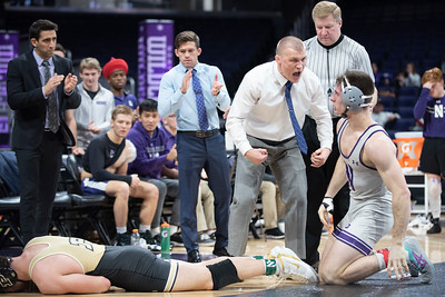 Northwestern University Wrestling coaching staff celebrates as Lucas Davison upsets the No. 2 Christian Brunner during Davison's Big Ten debut on January 10, 2020 in Evanston, Illinois. | Colin Boyle/Northwestern Athletics