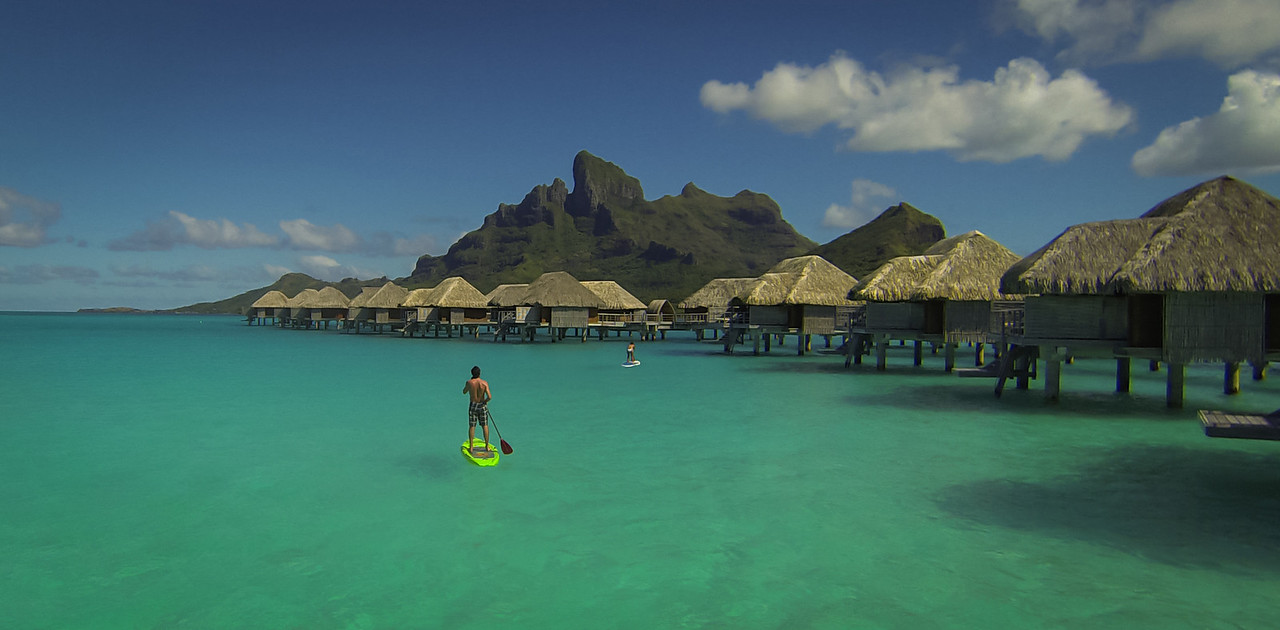 Paddle Boarding On Smooth Water