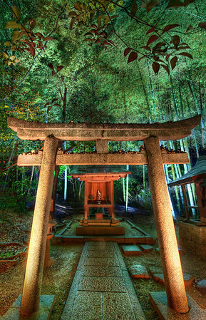 Hidden Temple in Bamboo at Night This place was pretty far off the usual beaten path but I was glad to find it!In Kyoto, there is a wonderful and unexpected temple that weaves through an old bamboo forest.  It weaves up, down, and around hills with warm, calming bamboo swaying about.  Here and there, little temples, urns, and benches are placed.  Everything is delicately lit to add to the mood.  And just beyond where the lights are, the bamboo forest is pitch black and full of wonderful mystery.- Trey RatcliffClick here to read the rest of this post at the Stuck in Customs blog.