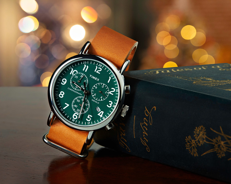 Timex Watch Leaning Against Book