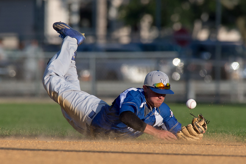 Wallingford's Joe Gulino dives to stop a ground ball Wednesday at West Side Field in Wallingford Jun. 28, 2017 | Justin Weekes / For the Record-Journal
