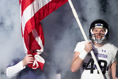 Northwestern University punter Jake Collins holds the American flag prior to the Big Ten Football Championship Game in Indianapolis, IN on December 1, 2018. | Colin Boyle/The Daily Northwestern