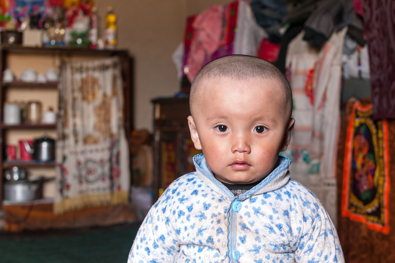 Young Kirgiz boy. Yashikul - M41 Pamir Highway via Ak Jar. Tajikistan