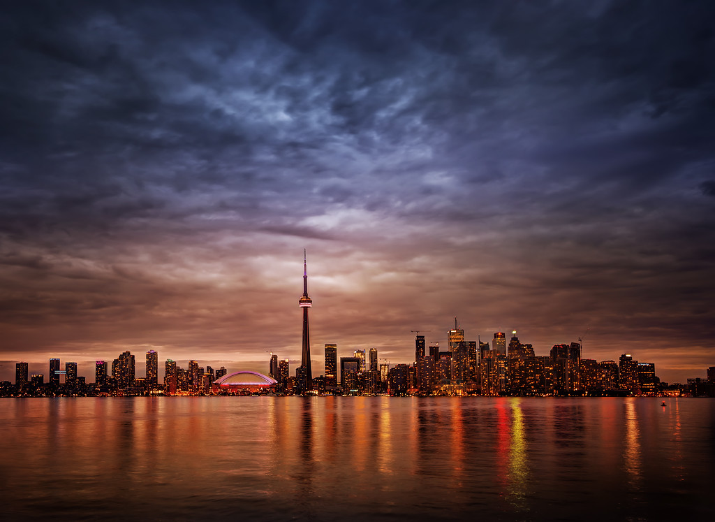 Great Night in Toronto After a super-long day, I decided to make it super-longer by joining all the TBEX crew over at a party on Centre Island. I'm not a total expert of the-best-places-to-shoot-Toronto, but this area seems good enough!This was a three-photo HDR taken with the Sony NEX-7. I'm still working on that larger story where I compare the NEX-7 to the Nikon D800… that is coming soon…It was quite a rainy night, so between squalls I ran out there to take a bunch of photos. Since my tripod was lost, I had to borrow a tripod from good man Edgar Van Der Meer. Thanks again Edgar! - Trey RatcliffClick here to read the rest of this post at the Stuck in Customs blog.