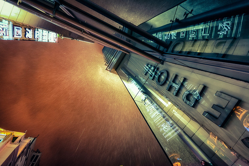 <h1>Into the Rain at Shanghai</h1> <p>A rainy night in Shanghai looking up a building. There seemed to be a wind vortex in this spot that was blowing the rain away. I was able to point up into the sky without any rain landing on my lens.<p>