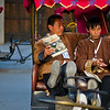 "<h2>Cart Runners in Old Beijing</h2> <br/>There are many old pockets scattered all over Beijing.  I haven't become totally familiar with all the names of these quadrants yet, but I should get another chance to re-visit all these places.  This is actually kind of a weakness in the whole ""travel blog"" thing.  See, a REAL travel blogger would memorize the names of all these places and spout them back to you.  But, here is my excuse... and maybe it is not really that bad... but, to me, this kind of photo could be taken in many different places.  The exact neighborhood does not matter.  In fact, by NOT telling you the spot, you may be more likely to find it just by wandering about.<br/><br/>These uniformed guys sat together in between jobs and had a rest.  I don't know what struck me about it, but it just seemed like a nice little moment. <br/><br/>- Trey Ratcliff<br/><br/><a href=""http://www.stuckincustoms.com/2011/04/16/cart-runners-in-old-beijing/"" rel=""nofollow"">Click here to read the rest of this post at the Stuck in Customs blog.</a>"