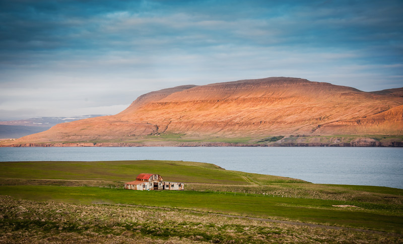 """<h2>Driving High Along the Fjords</h2> <br/>The roads in Iceland normally follow the bottom part of the valley. Here, in this particular area, the road was about halfway up one of the mountains, which gave me a bit of a downward perspective. Every few miles there is an interesting, old, weather-beaten barn like this one to set the scene. It may not even be so old, and maybe the weather there is so rough that it makes things look old before their time.<br/><br/>- Trey Ratcliff<br/><br/><a href=""""http://www.stuckincustoms.com/2013/04/20/driving-high-along-the-fjords/"""" rel=""""nofollow"""">Click here to read the rest of this post at the Stuck in Customs blog.</a>"""