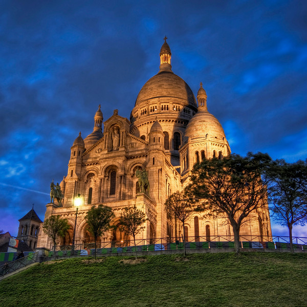 "<h2>La Basilique du Sacre Coeur de Montmartre</h2> <br/>This is a famous basilica in Paris.  It sits high on a hill and is beautifully lit in the evening.  This is the birthplace of the Jesuits back in 1534.  That is only interesting to me because I was a Jesuit student myself back in the day.  You would think that would mean that I would be allowed to come inside to take all the photos I want with a special key that everyone gets upon graduation.  But I had no such key so I was forced to stay on the perimeter with all the other heathens.<br/><br/>- Trey Ratcliff<br/><br/><a href=""http://www.stuckincustoms.com/2007/11/30/la-basilique-du-sacre-coeur-de-montmatre/"" rel=""nofollow"">Click here to read the rest of this post at the Stuck in Customs blog.</a>"