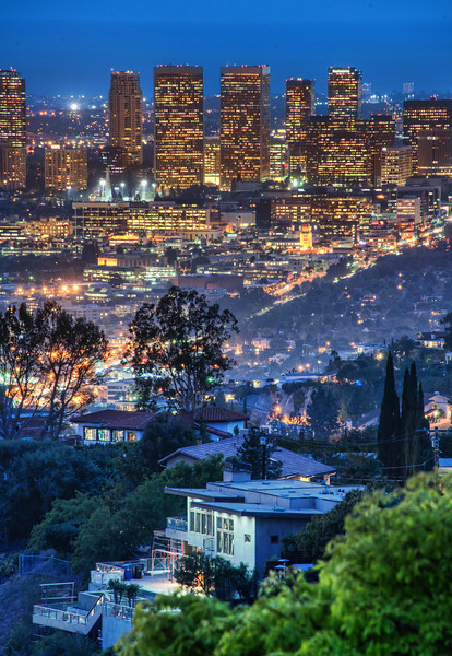 A view of the city from the Hollywood Hills One night, Tom and I went up to the top of Runyon Canyon to shoot the city. On the walk up, I liked the view of one of the palatial Hollywood Hills homes through the valley. I zoomed in with my 28-300 mm lens to get this shot.If you're ever in LA and looking for some new types of city shots, take a hike around Runyon during the sunset. You may find some cool scenes!- Trey RatcliffClick here to read the rest of this post at the Stuck in Customs blog.