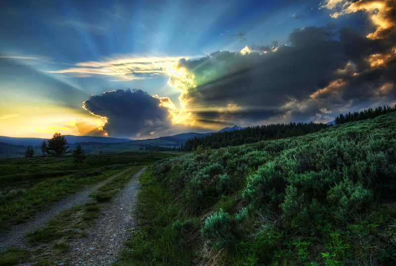 "<h2>The Dirt Road to the Nuclear Blast Site</h2> <br/>I felt lucky to have a wild sunset in Yellowstone! I've probably been to Yellowstone 5 or 6 times, and you never know what you'll get! This night was perfect… I had woken up early, so I was tired by mid-afternoon.. I took a catnap in my car and woke up to see the sun was going down in less than an hour! So, I looked at my map and figured out some good spots to go. While walking down this little dirt road, I thought the sky was too perfect to ignore, so I set up for a quick shot!<br/><br/>- Trey Ratcliff<br/><br/><a href=""http://www.stuckincustoms.com/2009/10/28/the-dirt-road-to-the-nuclear-blast-site-and-onone-plugin-suite-5-avail/"" rel=""nofollow"">Click here to read the rest of this post at the Stuck in Customs blog.</a>"