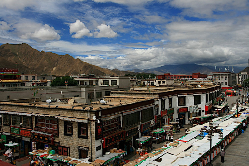 Rooftop view of the city of Lhasa in Tibet, China. The altitude here is high, and it seems as if the skies are always blue.  This was taken just after I had finished a 50 hour train journey from Beijing to get here.