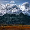 "<h2>The Violent Volcano</h2> <br/>I thought this mountain and cloud formation was too perfect to ignore.  Clouds always do strange things when they pass over mountains, but this one seemed particularly violent and unexpected.<br/><br/>This is not actually a volcano.  it's just a regular old mountain in the Andes that had a nice little volcanic shape.  I skirted around it for a while (skirting is quite a trek at this radius), until the angle seemed about right... although I had to skirt fast before the clouds changed.  I have always wanted to take a photo of a volcano that is erupting.  I climbed up part of a volcano that was erupting in Costa Rica, and you could see the red rocks, but I got absolutely zero good shots.  Oh well... some day!<br/><br/>- Trey Ratcliff<br/><br/><a href=""http://www.stuckincustoms.com/2009/05/16/the-violent-volcano/"" rel=""nofollow"">Click here to read the rest of this post at the Stuck in Customs blog.</a>"