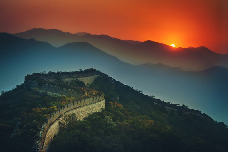 The Great Wall Stretches Across the SunsetBeautiful China! Isn't the Great Wall an awesome thing? It's so epic in every way. I do what I can to make it feel as epic as it deserves. On one of my nights there, the sun dipped halfway behind a hill. I saw it happening while I was walking along the wall by myself, so I set up for this shot…- Trey RatcliffClick here to read the rest of the post at the Stuck in Customs blog.