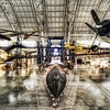 "<h2>The Blackbird in the Hangar</h2> <br/>You may not even really need to be into planes to know about the Lockheed SR-71 Blackbird.  The way those letters and numbers fit together is almost poetic, isn't it?  SR-71.  There is a melody to it that flows in a nice way.  It almost makes me wonder if there is some military muse that comes up with some of the better names for these vehicles.<br/><br/>In the background there, waaay in the rear area, you can see the space shuttle ... <br/><br/> - Trey Ratcliff <br/><br/>Read the rest of this entry <a href=""http://www.stuckincustoms.com/2010/08/16/blackbird-sr7/"">here</a> at the Stuck in Customs blog."
