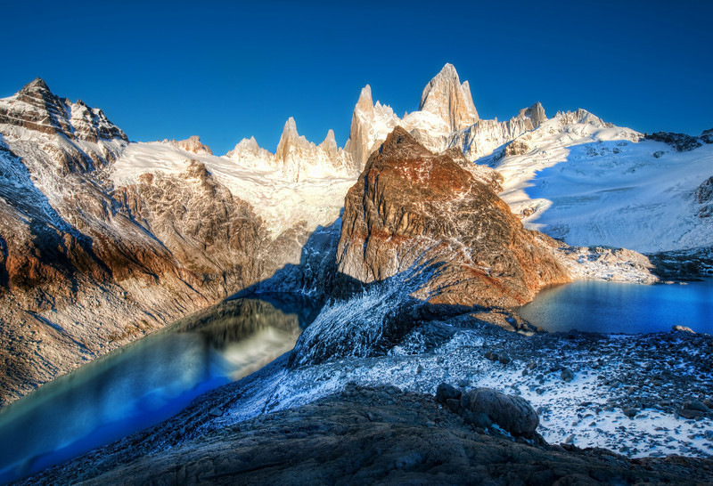"""<h2>The Two Glacial Lakes of the Southern Andes</h2> <br/>This was a hard spot to reach!<br/><br/>It was quite a hike to get up here early in the morning, just as the sky was still in a dawn of deep blue.  The two lakes on either side are those pure glacial blue lakes that you sometimes see from airplanes and wonder, """"What's it like to be down there?""""  I'll tell ya - AWESOME!  I went down there and drank from the lakes like a guanaco on holiday.  It was incredible.<br/><br/>- Trey Ratcliff<br/><br/><a href=""""http://www.stuckincustoms.com/2009/10/29/the-two-glacial-lakes-of-the-southern-andes/"""" rel=""""nofollow"""">Click here to read the rest of this post at the Stuck in Customs blog.</a>"""
