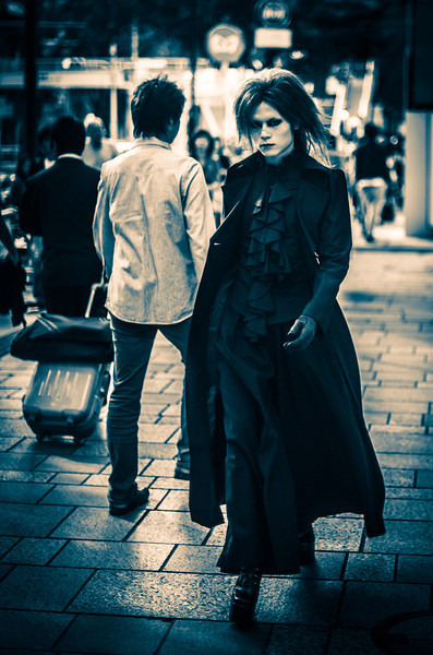 Goth in Tokyo While leaving Harajuku, I saw this guy walking towards the action. I still had on my 50mm prime and I wasn't quite close enough, but he had the right stride, so I took the shot. I cropped in quite heavily in post, and then I ran one of the new Trey's Lightroom Preset filters on it… In fact, I did this one during the class.- Trey RatcliffClick here to read the rest of this post at the Stuck in Customs blog.