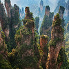 """<h2>Pandora from Avatar</h2> <br/>Getting to this place isn't easy, either.  I wish I could tell you how tired my legs were and still are.  I added about another 1/4 inch of calf muscle in the last week.  Climbing these spires with all my equipment is not cake walk.  I climbed to the top three times in my hikes, and my first day had about 10km of unforgettable pain.  10km is one thing.  10km that involves these kinds of verticals is another thing.<br/><br/>I also climbed one of these at night.  Alone.  That was exciting.  I don't know if exciting is quite the right word for it, but it certainly was an experience (that word said with French accent).  On the way down, I ran into a big snake that would have liked nothing more than to rock my face off.  I'll have a full story on that in a later post from this area.<br/><br/>- Trey Ratcliff<br/><br/>Read the rest <a href=""""http://www.stuckincustoms.com/2010/10/17/zhangjiaji/"""">here</a> at stuckincustoms.com."""