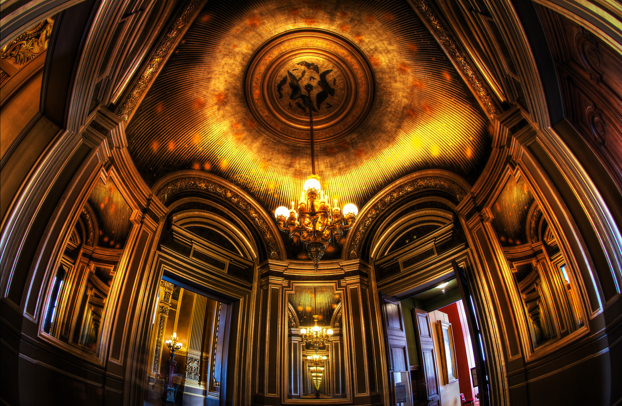 The Mysterious Places of Paris Isn't this room amazing? It's not in the main part of the Paris Opera House, but it had the most ornate and Inception-esque room I've seen in a while. I took this photo while in the middle of experimenting with the Nikon fisheye lens. It seemed to fit the bill for these ornate grand locations that are still in a relatively confined space. - Trey RatcliffClick here to read the rest of this post at the Stuck in Customs blog.
