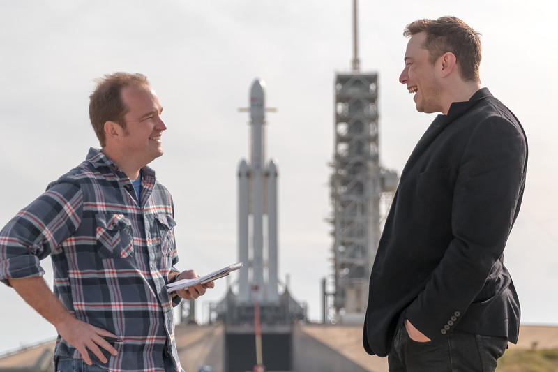"Elon Musk laughs as Ars Technica's Senior Space Editor Eric Berger says ""This is Ars Technica"" in response to Musk's inquiry: ""Can I be technical?"" at Launch Complex 39A inside NASA's Kennedy Space Center the day before the rockets' maiden flight."