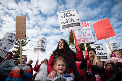 Jennifer Yen, special education teacher at Alexander Graham Bell School, joins the rally as Chicago Public Schools teachers picket early Thursday morning at Lane Tech High School on the first day of the teacher strike on October 17, 2019. | Colin Boyle for the Sun-Times