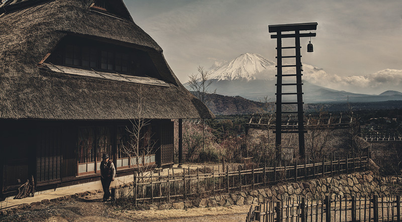 "Ancient Mount Fuji Village Here I am in that little village of Saiko. I don't know if it is always relatively empty or just this one day, but hardly anyone was around. I did see this one older gentleman sauntering around, and he happened to saunter right into the frame! A lucky grab! :)This ""look"" for this photo is a bit experimental, but I kind of like it. To achieve it (this is Photoshop-heavy-jargon I'm afraid!), you can duplicate the layer then do some extreme sharpening and a black and white conversion using something like Silver Efex Pro (there is a review here on the site). After that, you can change the blend mode to Hard Light… it makes an interesting effect!- Trey RatcliffClick here to read the rest of this post at the Stuck in Customs blog."