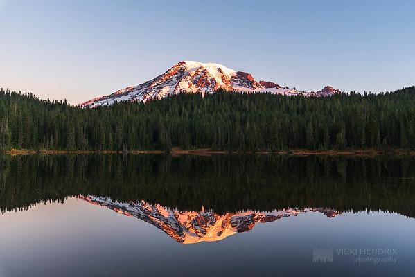 Sunrise alpenglow on Mount Rainier at Reflection Lake - Mount Rainier National Park, Washington