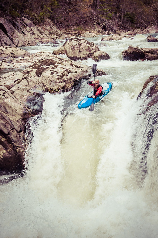 A kayaker about to drop State-line Falls on the Watauga River outside of Boone, North Carolina.  The Watauga River gorge offers some of the best class V whitewater around.
