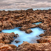 "<h2>The Alien Pool</h2> <br/>If you have ever seen this area of Southern Iceland, then you can attest to these amazing colors! These are totally accurate…. and I would find it hard to believe had I not seen it first hand.  It was my first time to this area in the summer. Do you see those strange rocks? Well, some of what you are seeing is rocks and the rest is a very unusual moss. It's a tan-green color. It's extremely fuzzy/spongy and makes the whole place just seem unworldly. That, combined with the extra-blue water, made for a scene that was just shockingly awesome.<br/><br/>- Trey Ratcliff<br/><br/><a href=""http://www.stuckincustoms.com/2010/06/13/the-alien-pool/"" rel=""nofollow"">Click here to read the rest of this post at the Stuck in Customs blog.</a>"