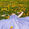 Lounging in a field of poppies