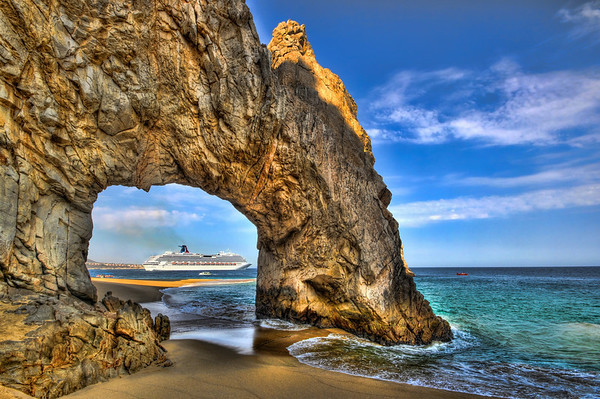 Carnival Splendor leaving Cabo San Lucas, as seen through the Arch at Land's End.