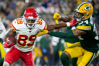 Green Bay Packers safety Tray Matthews (34) is held back by a Kansas City Chiefs' wide receiver Rashard Davis (89) during a preseason game in Green Bay, Wis. on Thursday, August 29, 2019. | Colin Boyle/Milwaukee Journal Sentinel