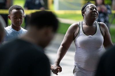 A woman reacts as a prayer circle, orchestrated by Milwaukee Police Department Chaplain Malcolm Hunt, is held after a 5-year-old boy was fatally shot on Tuesday, June 18, 2019 at 45th Street and Concordia Avenue. Colin Boyle/Milwaukee Journal Sentinel