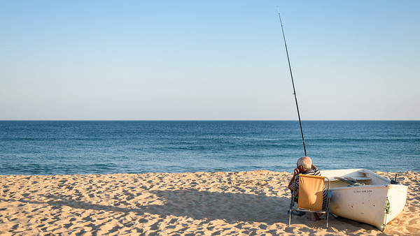 Fisherman on Praia Salema, Algarve