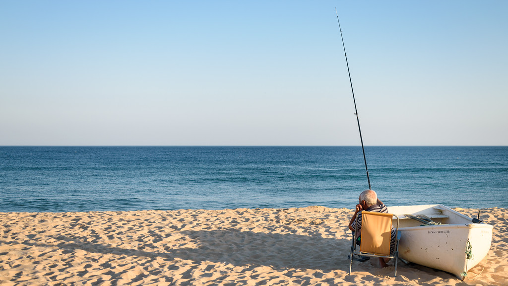 Fisherman on Praia Salema, Algarve