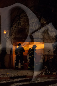 Firefighters work to control a house fire on Varian Ln. in Gates, NY. This was the second of two fires reported within an hour in the town. January 20, 2012.