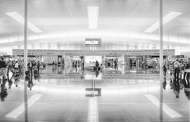 "<h2>The Barcelona Airport II</h2> <br/>This is another reason I like to get to airports early.  Not only do I hate being rushed, but I like to take time to explore with my camera.  Well, I guess that only is in the case where the airport happens to be particularly beautiful, like the one here in Barcelona.  I always start out extremely rushed, because I picture security closing down on me from every angle.  So, my first shot is usually rushed and not perfectly centered.  Then, if the guards don't gang-tackle me like I'm streaking at Yankee Stadium, then I keep adjusting my position and the camera until things are more and more aligned and composed to my satisfaction.  This one was even a little bit tilted, but I fixed that bit with the crop tool later in Photoshop (as people saw). <br/><br/> - Trey Ratcliff <br/><br/>Read more <a href=""http://www.stuckincustoms.com/2011/05/18/the-barcelona-airport/"">here</a> at the Stuck in Customs blog."