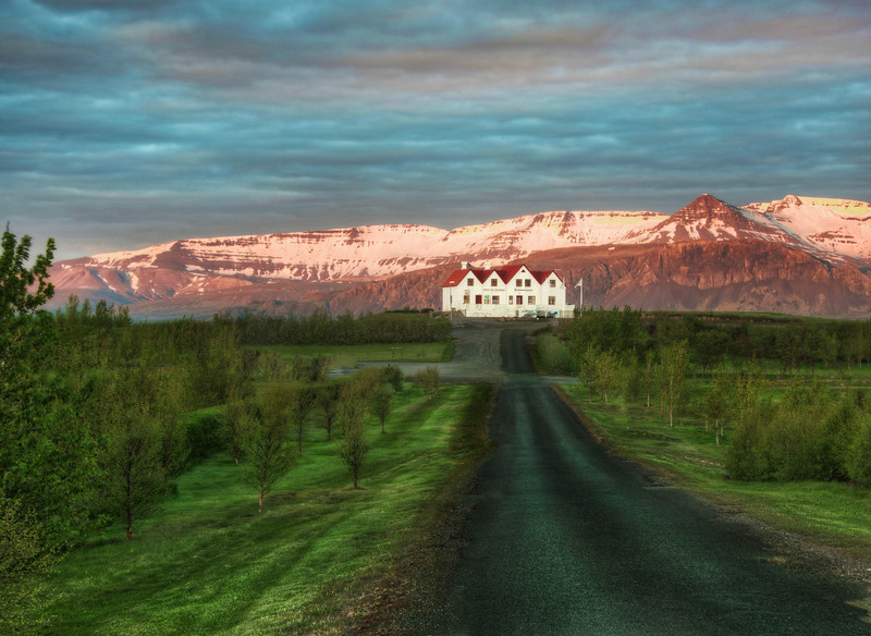 """<h2>Road to the Inn</h2> <br/>I have strange feelings sometimes when approaching new hotels. I stay in a lot of them, but there are certain times of the day and night when you are going some place quite foreign and you're just not sure what it will be like.<br/><br/>A good example is this place here in Iceland, where everything can be doubly strange. I've had many strange experiences from sleeping in school classrooms (they are converted to hotels in the summer) to having to wake up someone at 2 AM to let me into a room.<br/><br/>Even though Iceland is so mountainous, sometimes there are wide open plains where you can see the destination from miles and miles away as you get closer. And all the strange thoughts (especially very late at night) go racing through your head. It's all kind of Twilight Zone-ish.<br/><br/>- Trey Ratcliff<br/><br/><a href=""""http://www.stuckincustoms.com/2012/07/11/approaching-the-hotel/"""" rel=""""nofollow"""">Click here to read the rest of this post at the Stuck in Customs blog.</a>"""