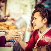 Woman Getting Goodies in Tokyo