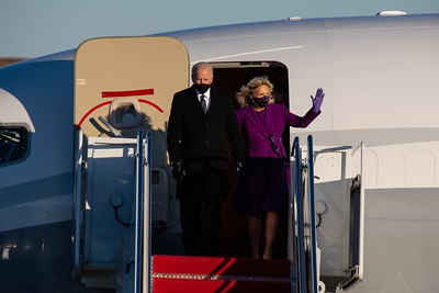 U.S. President-elect Joe Biden steps off a Boeing BBJ with his wife Jill Biden while arriving to Joint Base Andrews, Maryland, U.S., on Tuesday, Jan. 19, 2021. Biden's arrival, on the eve of his inauguration, with the usual backdrop of celebrations and political comity has been replaced by a military lockdown. Photographer: Eric Lee/Bloomberg