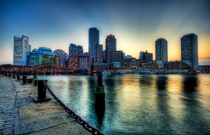 Boston at Sunset Boston is great and I am sad I've only spent a short amount of time there. On this evening, I walked along the waterfront here to look at all the various angles and light levels. They were all good! That's a sign of a good city when it is hard to take a bad photo of it!  - Trey Ratcliff  Read more here at the Stuck in Customs blog.