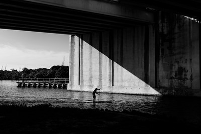 Brian Corbitt during a race paddling under the bridge