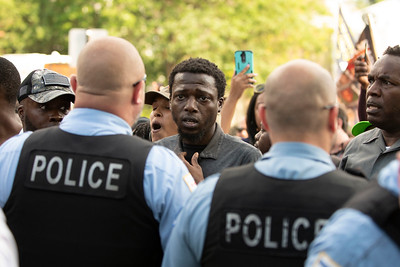 Police and protesters confront one another the day after the shooting of Harith Augustus on July 15, 2018. | Colin Boyle/Sun-Times