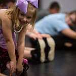 Nadav Soroker/Times-Georgian<br /> <br /> Paisley Phillips, 6, grabs her toes during stretches at the Let Your Light Shine dance class at Fever Performing Arts' new location on Tom Reeve Drive, on Monday, October 15, 2018.