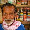 """<h2>This is Ranjit</h2> <br/>Ranjit's dream is that he gets to work in the factory again.<br/><br/>Ranjit is currently sitting in front of an old restaurant on the outskirts of Kuala Lumpur.  He used to work in a nearby factory, making aluminum parts, but he was replaced after his cataracts got too heavy and he began making mistakes.  Ranjit does not like being a burden on his son, who doesn't come to see him much anymore.  He says, motioning off into the distance behind me, """"The boy is in Putrajaya, living in government house.""""  He keeps reaching out in that direction, groping around, as if he is trying to find a light switch in the dark.<br/><br/>- Trey Ratcliff<br/><br/><a href=""""http://www.stuckincustoms.com/2006/10/25/this-is-ranjit/"""" rel=""""nofollow"""">Click here to read the rest of this post at the Stuck in Customs blog.</a>"""