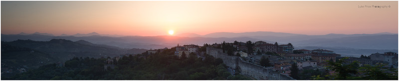 as the sun rises over Perugia