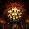 "<h2>Fun with the Fisheye in Paris</h2> <br/>This is a close up of one of the two chandeliers in the entry way of my hotel in Paris. I was still getting used to the fisheye at this point, so it took me about five shots to get this exact one I wanted.<br/><br/>By the way, I like how Paris likes to fill ""empty space"" with red velvet. It's like the go-to thing for interior designers there…<br/><br/>- Trey Ratcliff<br/><br/><a href=""http://www.stuckincustoms.com/2013/04/22/fun-with-the-fisheye-in-paris/"" rel=""nofollow"">Click here to read the rest of this post at the Stuck in Customs blog.</a>"