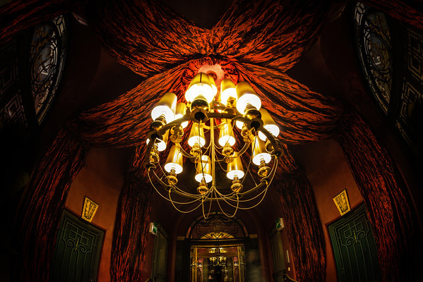 "Fun with the Fisheye in Paris This is a close up of one of the two chandeliers in the entry way of my hotel in Paris. I was still getting used to the fisheye at this point, so it took me about five shots to get this exact one I wanted.By the way, I like how Paris likes to fill ""empty space"" with red velvet. It's like the go-to thing for interior designers there…- Trey RatcliffClick here to read the rest of this post at the Stuck in Customs blog."