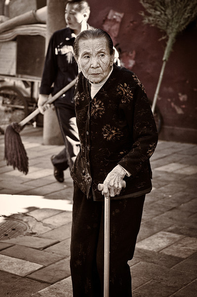 "<h2>Old Woman in Beijing</h2> <br/>I spotted this old woman walking along the outside of the Forbidden City. Just like above, I took photos without any hesitation before she noticed what was going on. I shared the photo with her after, and we had a nice little moment.<br/><br/>- Trey Ratcliff<br/><br/><a href=""http://www.stuckincustoms.com/2011/10/04/5-more-tips-for-photographing-people/"" rel=""nofollow"">Click here to read the rest of this post at the Stuck in Customs blog.</a>"
