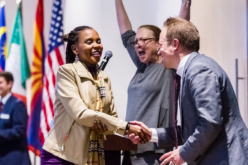 John Chaides / Lumberjack<br /> Evalyne Jengarwa, form Tanzania, shakes Daniel Plam's, Associate Vice President for Global Initiatives, hand at Northern Arizona University's International Graduation at the International Pavilion on Friday, December 7, 2018.